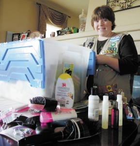 Nelly Grantham from Thornton sorts through a bin of personal hygiene products. The Horizon High School senior recently earned her Gold Award, which is the highest honor for a Girl Scout. For her Gold Award project, she gathered 6,000 personal hygiene items that were donated to Westminster nonprofit Growing Home. Photo by Ashley Reimers.